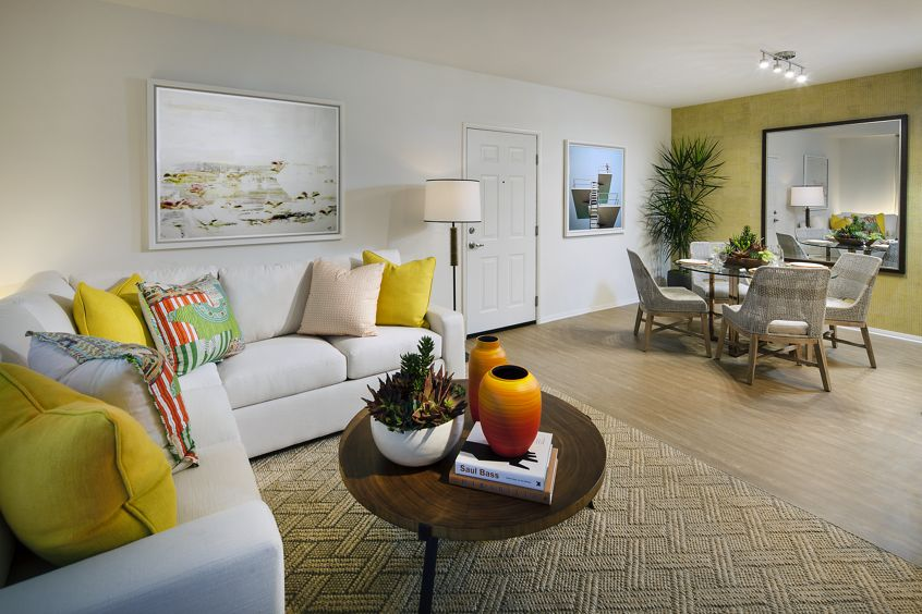 Interior view of living room and dining room at Turtle Ridge Apartment Homes in Newport Beach, CA.