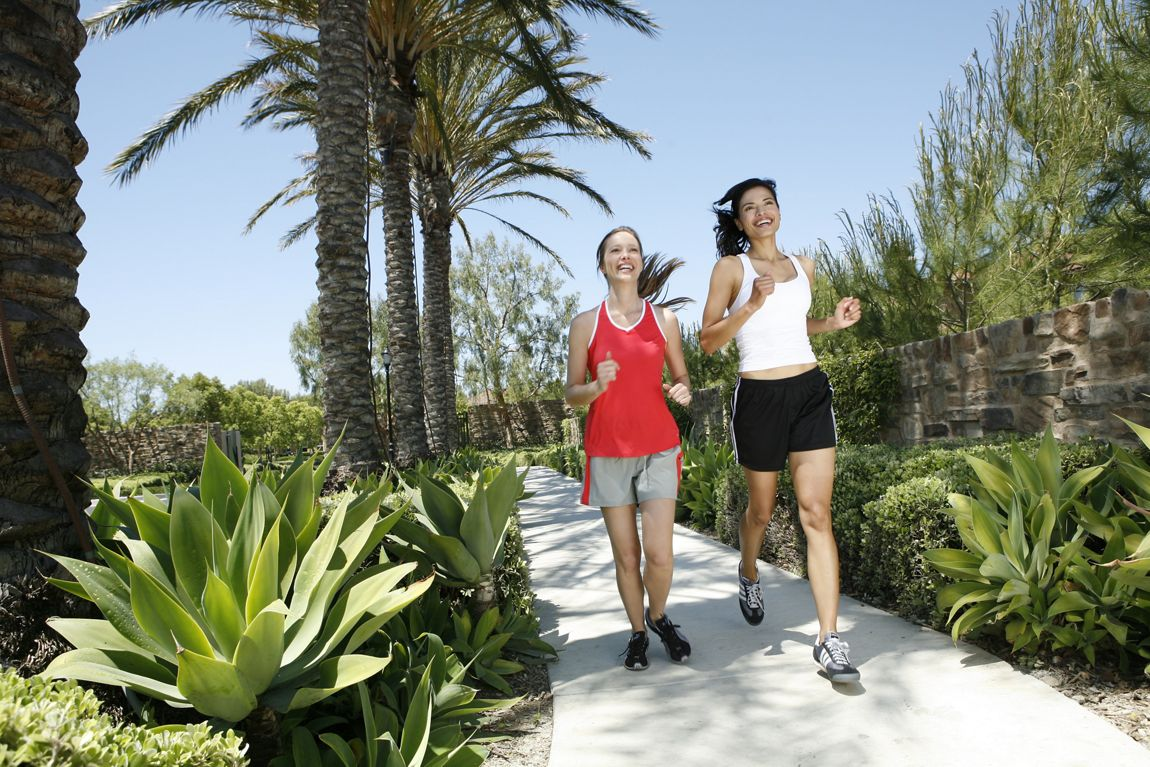 View of two women jogging at Turtle Ridge Apartment Homes in Newport Beach, CA.