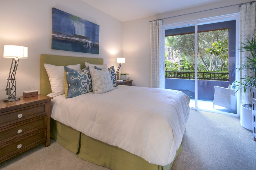 Interior views of bedroom and patio at Gateway Apartment Homes in Orange, CA.