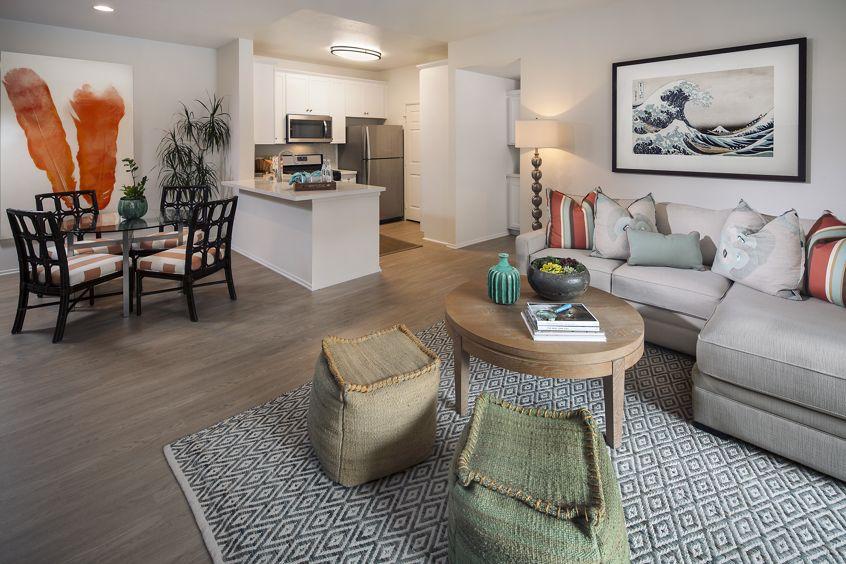 Interior view of the kitchen and living room at Las Flores Apartment Homes in Rancho Santa Margarita, CA.