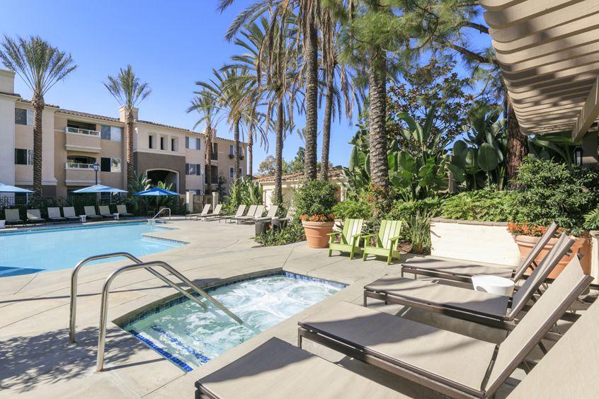 Exterior view of the pool and jacuzzi at Las Flores Apartment Homes in Rancho Santa Margarita, CA.