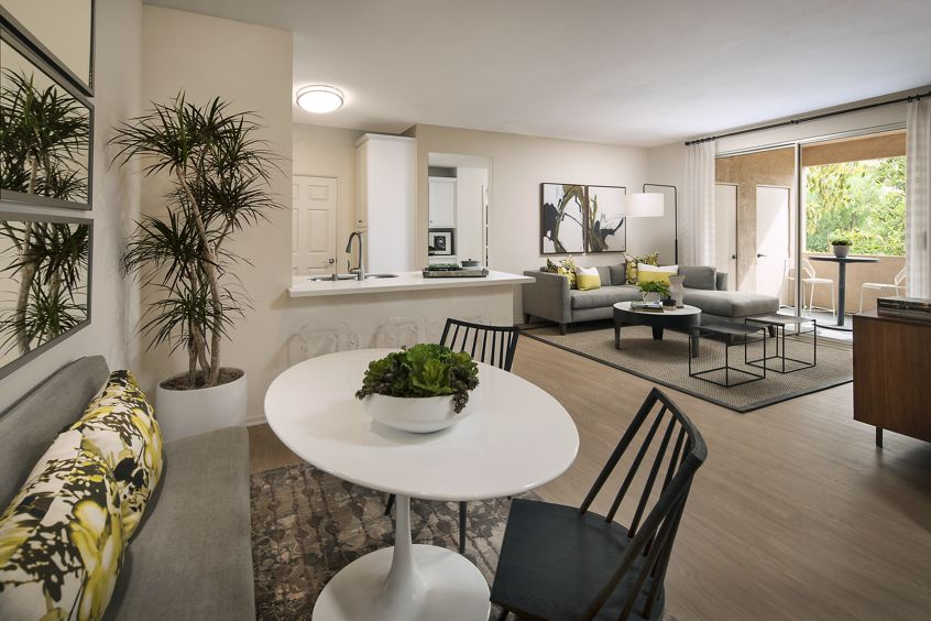 Interior view of the dining area and living room at Las Flores Apartment Homes in Rancho Santa Margarita, CA.