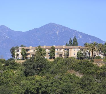 View of building exterior at Las Flores Apartment Homes in Rancho Santa Margarita, CA.