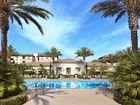 Pool view at Amalfi Apartment Homes in Tustin, CA.