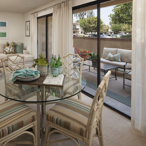 Interior view of living room and dining room at Rancho Alisal Apartment Homes in Tustin, CA.