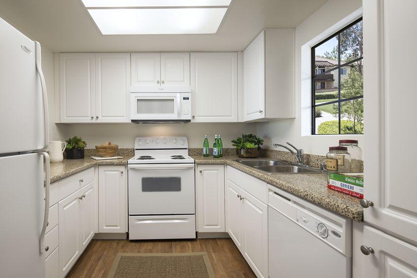 Interior view of kitchen at Rancho Alisal Apartment Homes in Tustin, CA.