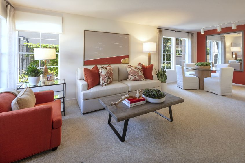 Interior view of living room and dining room at Rancho Maderas Apartment Homes in Tustin, CA.