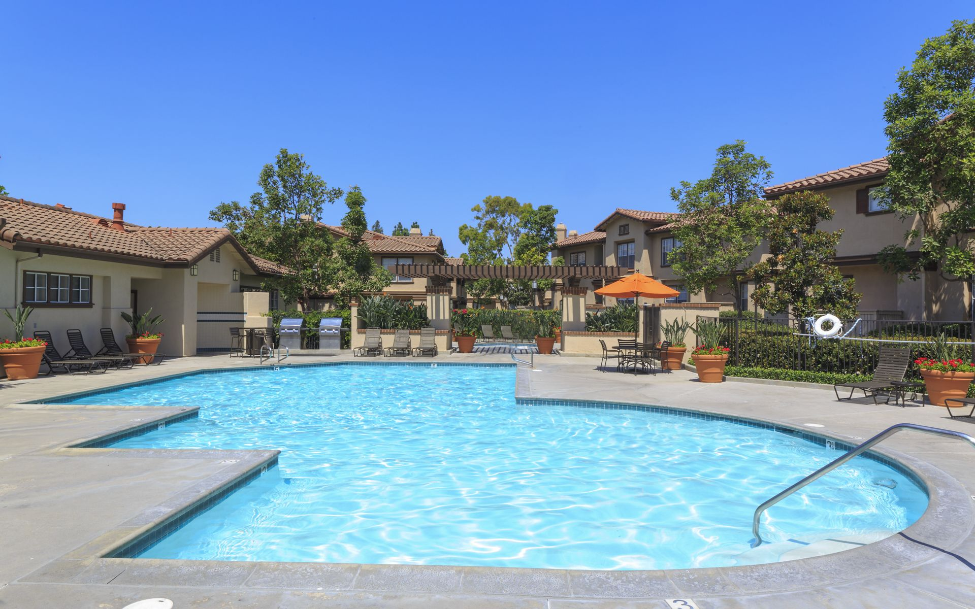 View of pool at Rancho Maderas Apartment Homes in Tustin, CA.
