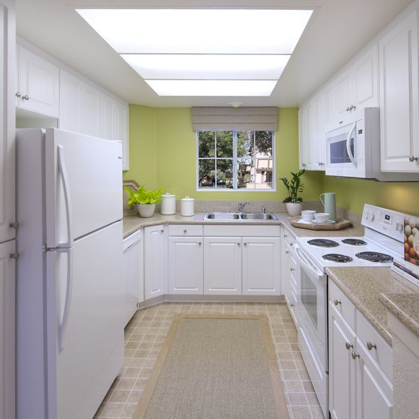 Interior view of kitchen of Rancho Maderas Apartment Homes in Tustin, CA.