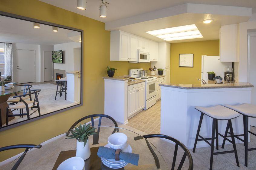 Interior view of kitchen at Rancho Maderas Apartment Homes in Tustin, CA.