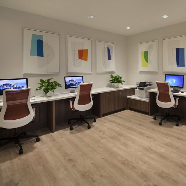 Interior view of business center iLounge at Rancho Mariposa Apartment Homes in Tustin, CA.
