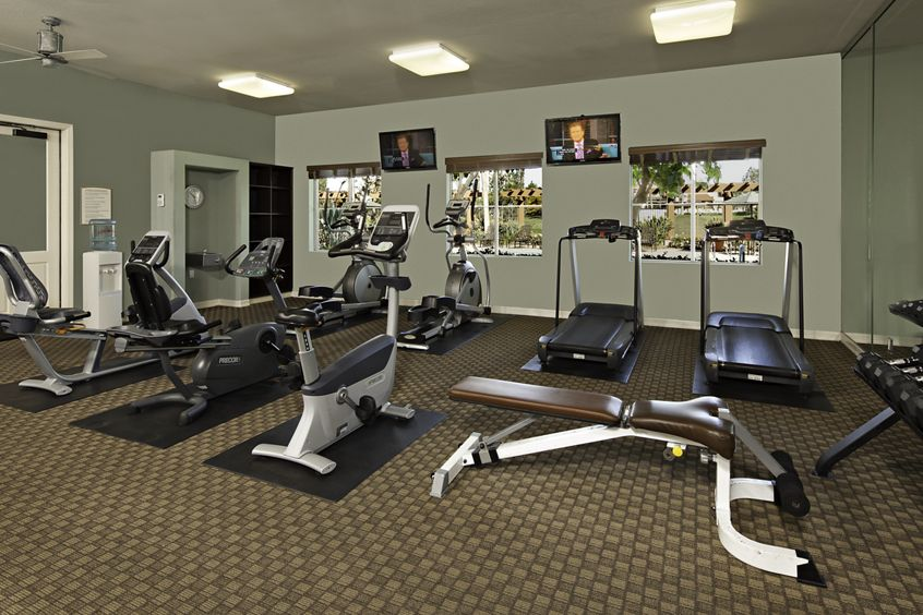 Interior view of fitness center at Rancho Monterey Apartment Homes in Tustin, CA.