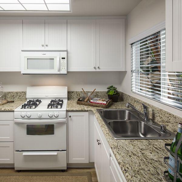 Interior view of kitchen at Rancho Santa Fe Apartment Homes in Tustin, CA.