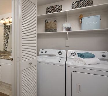 Interior view of laundry and bathroom at Rancho Santa Fe Apartment Homes in Tustin, CA.