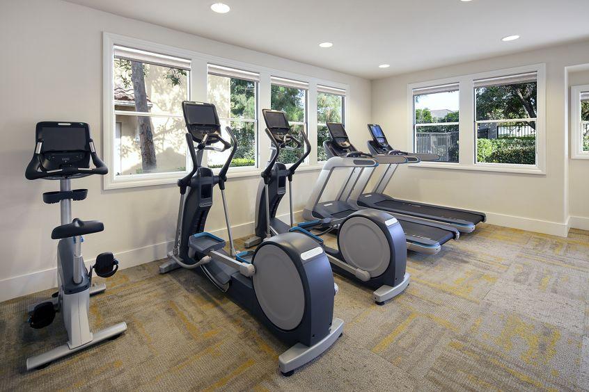 Interior view of fitness center at Rancho Santa Fe Apartment Homes in Tustin, CA.
