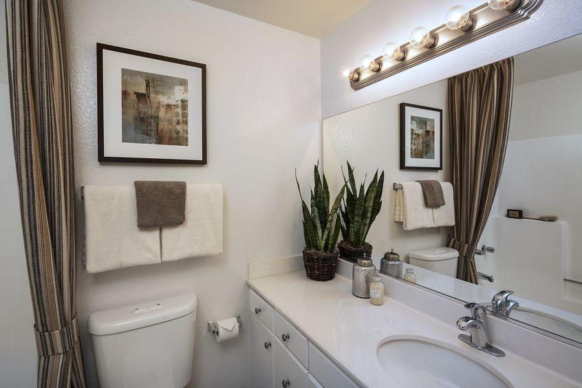 Interior view of bathroom at Rancho Tierra Apartment Homes in Tustin, CA.