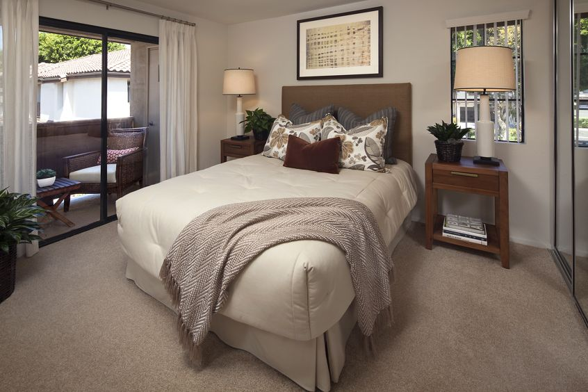 Interior view of bedroom at Rancho Tierra Apartment Homes in Tustin, CA.