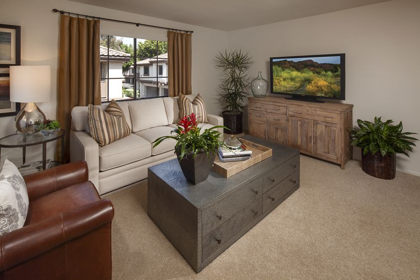 Interior view of living room at Rancho Tierra Apartment Homes in Tustin, CA.