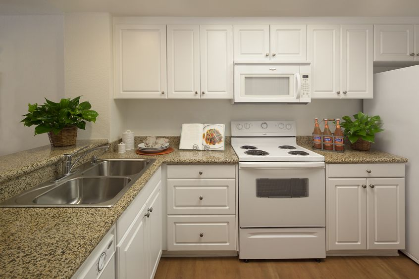 Interior view of kitchen at Rancho Tierra Apartment Homes in Tustin, CA.
