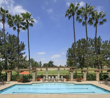 Exterior view of pool at Sierra Vista Apartment Homes in Tustin, CA.