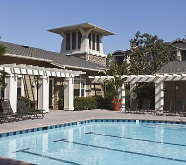 Exterior view of pool and club house at Arcadia at StoneCrest Village Apartment Homes in San Diego, CA.