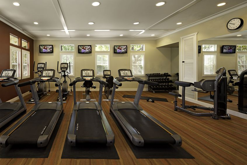 Interior views of fitness center at Arcadia at StoneCrest Village Apartment Homes in San Diego, CA.