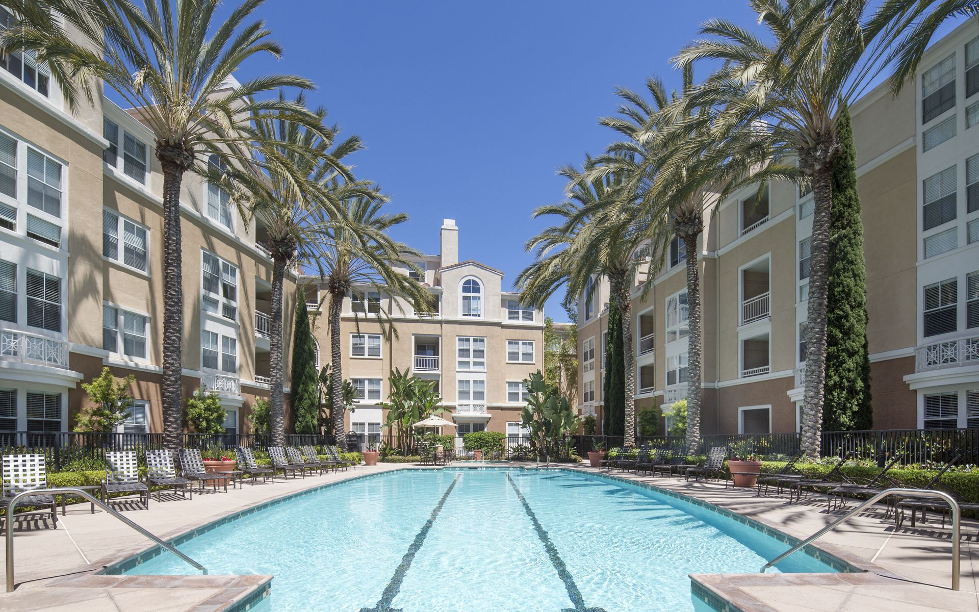 Exterior view of pool at La Jolla Palms Apartment Homes in San Diego, CA.