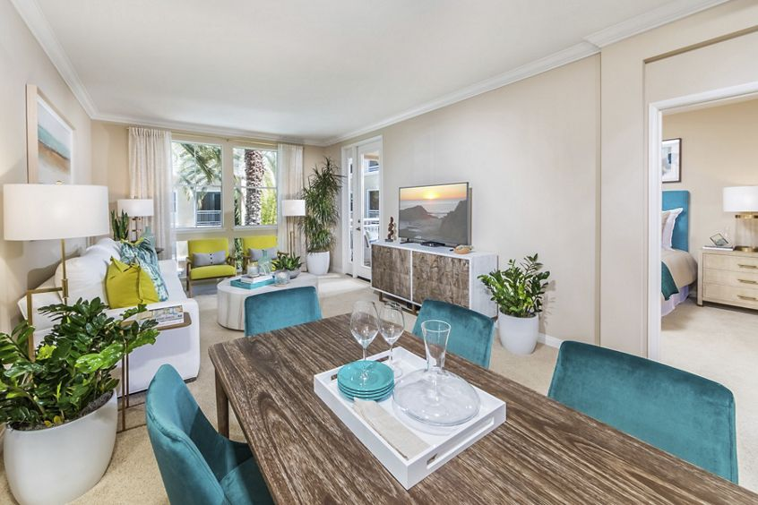 Interior view of dining room and living room at La Jolla Palms Apartment Homes in San Diego, CA.