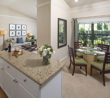 Interior view dining room and kitchen at Monte Vista Apartment Homes in Mission Valley, CA.