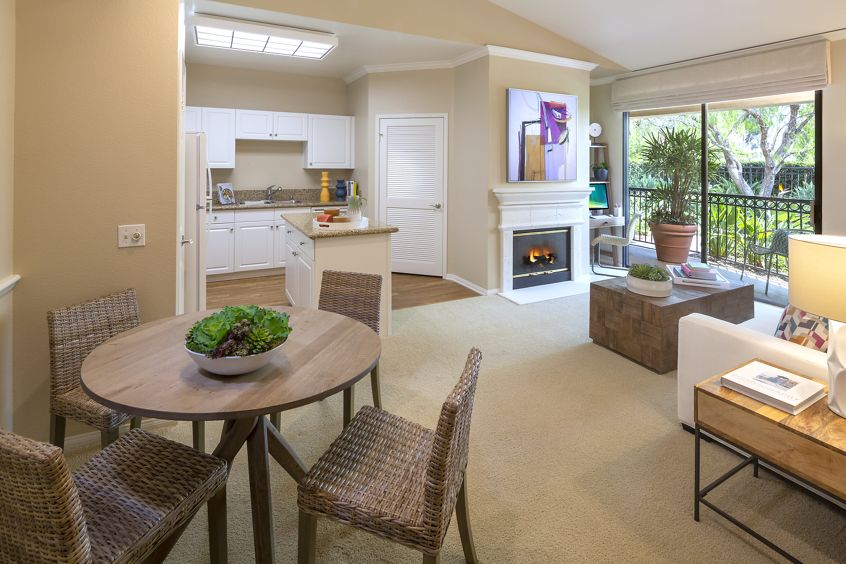 Interior view of  dining room and kitchen at Monte Vista Apartment Homes in Mission Valley, CA.