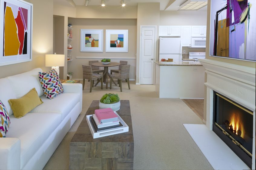 Interior view of kitchen, living, and dining at Monte Vista Apartment Homes in Mission Valley, CA.