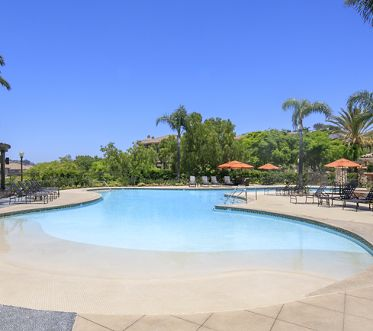 Exterior view of pool at Pacific View Apartment Homes in San Diego, CA.