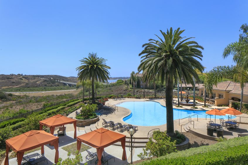 Exterior aerial view of pool at Pacific View Apartment Homes in San Diego, CA.