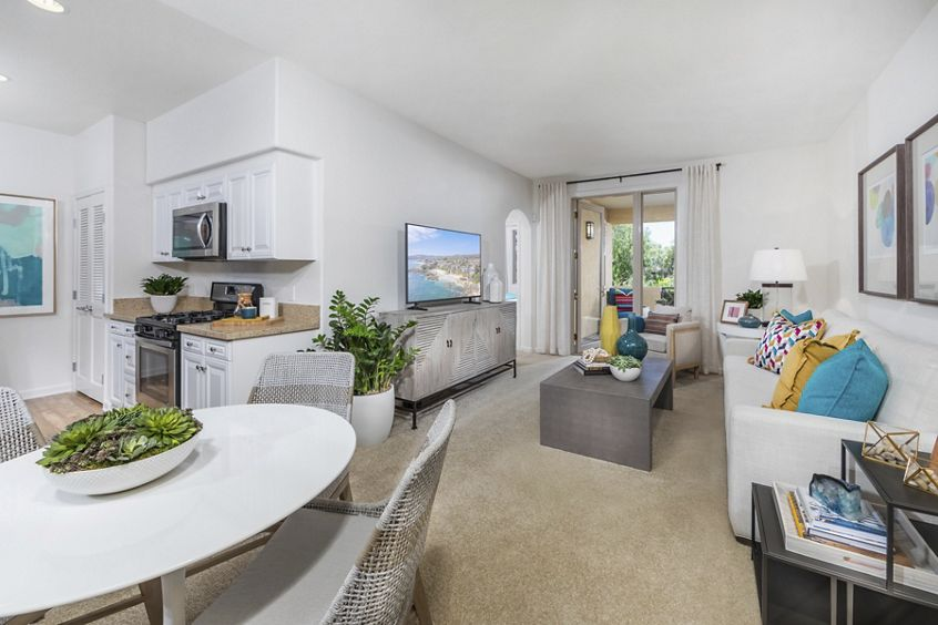 Interior view of living room and dining room at Pacific View Apartment Homes in Carlsbad, CA.