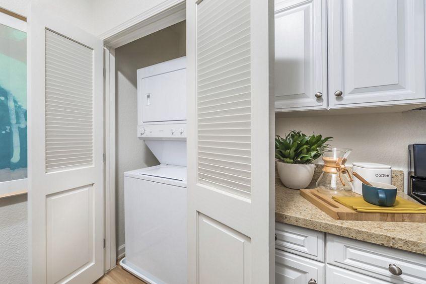 Interior view of laundry room at Pacific View Apartment Homes in Carlsbad, CA.