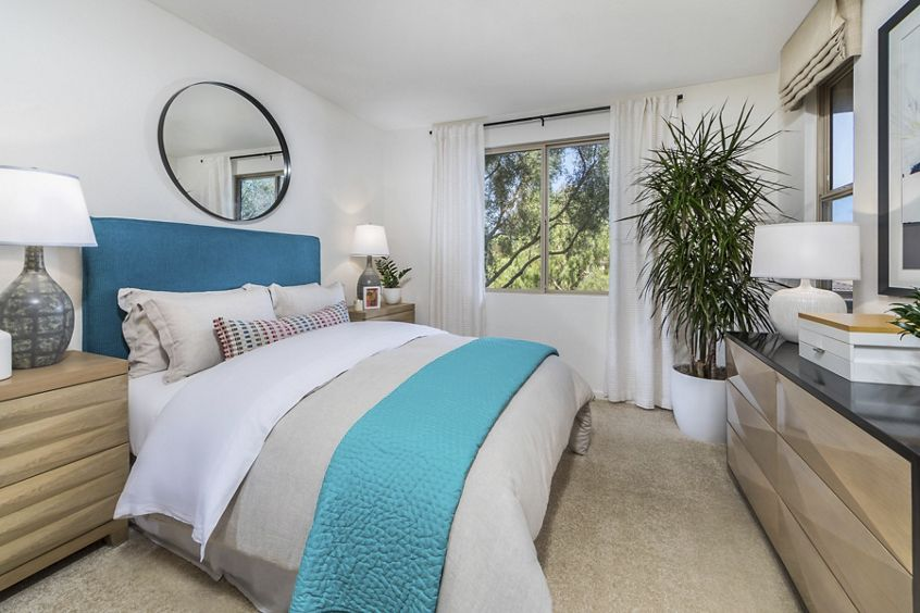 Interior view of master bedroom at Pacific View Apartment Homes in Carlsbad, CA.