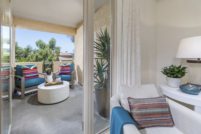 Interior view of patio balcony at Pacific View Apartment Homes in Carlsbad, CA.