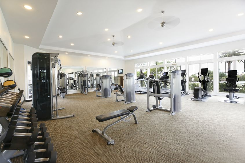 Interior view of fitness center at Pacific View Apartment Homes in Carlsbad, CA.