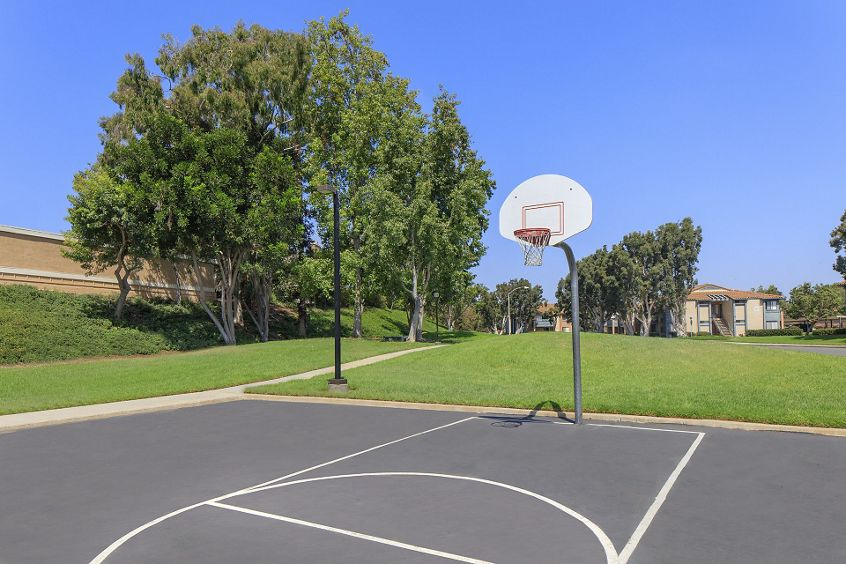 Exterior views of basketball court at Seascape Apartment Homes in Carlsbad, CA.