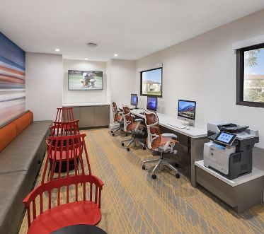 Interior view of iLounge business center at Seascape Apartment Homes in Carlsbad, CA.