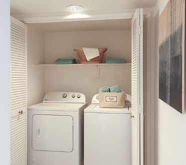 Interior view of laundry room at Solazzo Apartment Homes in La Jolla, CA.