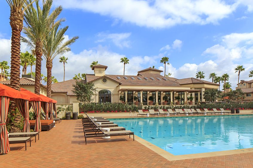 Exterior view of pool at The Village Mission Valley Apartment Homes in San Diego, CA.