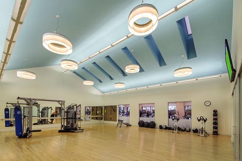 Interior view of fitness center at The Village Mission Valley Apartment Homes in San Diego, CA.