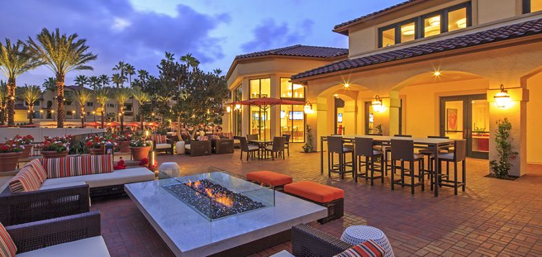 Exterior view of clubhouse at The Village Mission Valley Apartment Homes in San Diego, CA.
