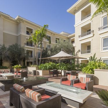 Exterior courtyard at The Village Mission Valley Apartment Homes in San Diego, CA.
