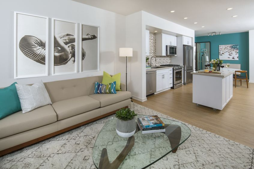 Interior view of living room and kitchen at The Village Mission Valley Apartment Homes in San Diego, CA.