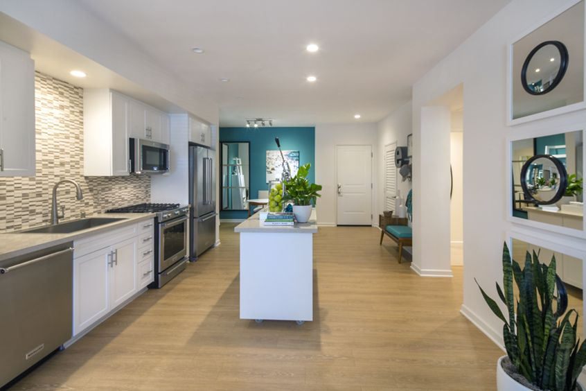 Interior view of entry and kitchen of The Village Mission Valley Apartment Homes in San Diego, CA.