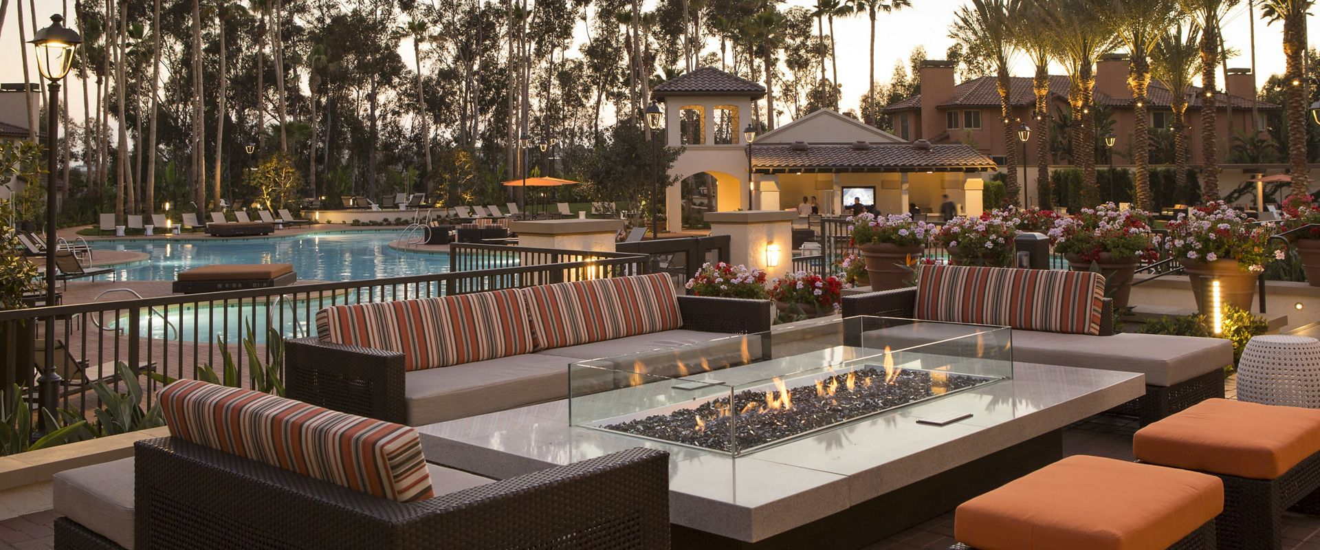 Exterior view of outdoor fireplace at The Village Mission Valley Apartment Homes in San Diego, CA.