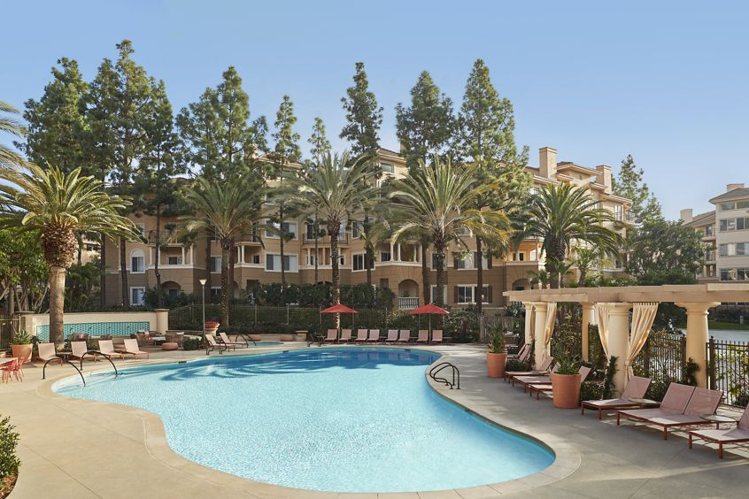 Exterior pool view of The Villas of Renaissance Apartment Homes in San Diego, CA.