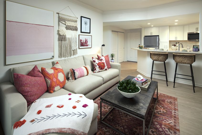 View of living room and kitchen at The Villas of Renaissance Apartment Homes in La Jolla, CA.